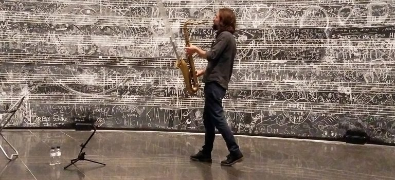 Tom Chant  performing at  Christian Marclay's Chalkboard,  MACBA, Barcelona, 29-7-2019